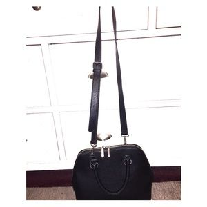 Charming Charlie black faux leather cross body bag